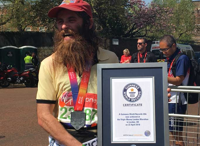 Rob Pope, dressed as Forrest Gump, after completing the London marathon
